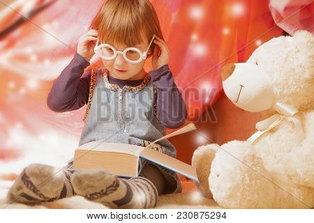Cute Little Child Girl Reading A Book With Teddy Bear Before Bedtime (sleep, Health, Childhood, Toys