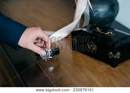 The Bridegroom Takes His Watch In His Hand. Preparing For A Wedding