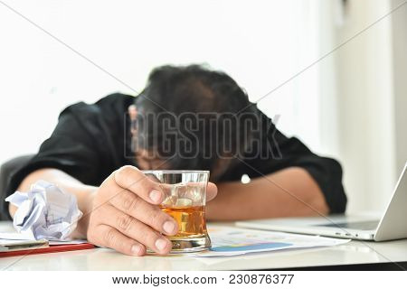 Alcohol Addicted Businessman Is Holding Whiskey Glass While Working With Laptop. Sad Depressed Patie