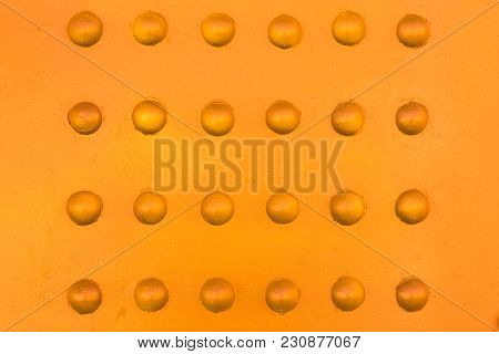 Rivets On Metal With A Touch Of Warm Color Background