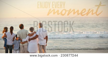 Beautiful family at the beach against enjoy every moment
