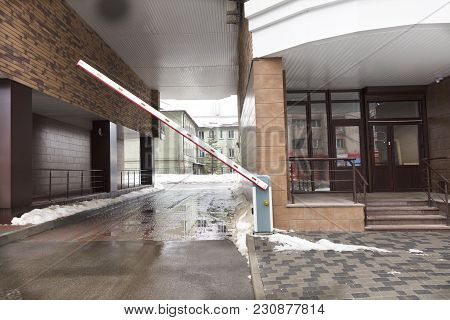 Automatic Barrier Gates To Enter The Courtyard Of The Building Serve As A Guard For The Residents Of