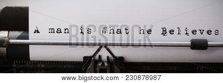 A man is what he believes against close-up of typewriter