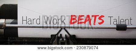 Hard work beats talent against close-up of typewriter