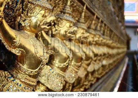 Golden Garuda Statues Ornament The Perimeter Of A Temple In The Royal Palace In Bangkok, Thailand.