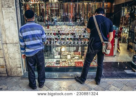 Tehran, Iran - October 15, 2016: Two Man In Front Of Shop Window Full Of Signet Rings And Misbaha Pr