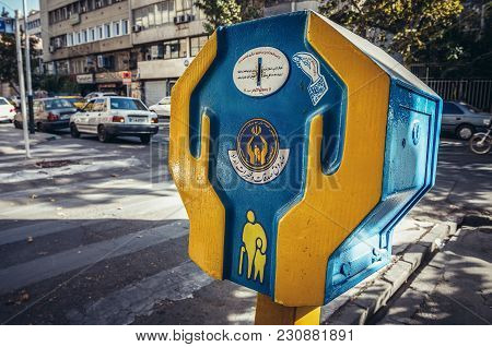 Tehran, Iran - October 15, 2016: Donation Box Of Khomeini Relief Foundation On A Sidewalk In Tehran