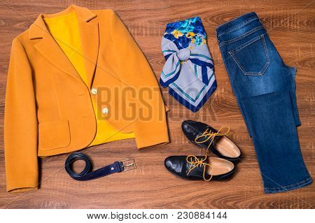 Set Of Stylish Female Clothes And Accessories On Wooden Background
