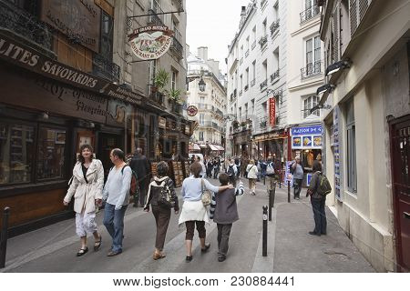 Paris, France - May 09, 2009. Visitors Outside Rue Saint Severin In Little Athens, The Latin Quarter