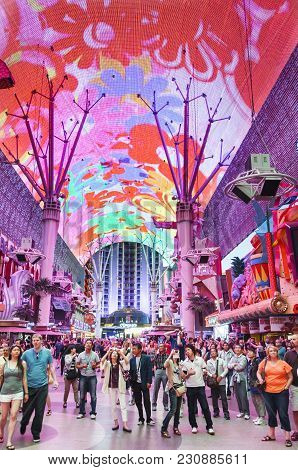 Las Vegas, Usa - May 19, 2012. Tourists Watch The Light Show On The Canopy Above Fremont Street. The