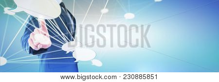 Side view of businessman using invisible imaginary interface against abstract blue background