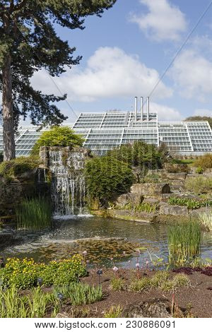 London, Uk - April 18, 2014. Rock Garden And Princess Of Wales Conservatory In Kew Botanic Gardens.