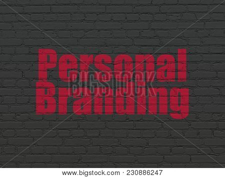 Advertising Concept: Painted Red Text Personal Branding On Black Brick Wall Background