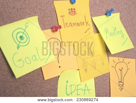 Teamwork And Idea Text On Sticky Note Or Post Is On Cork Bulletin Billboard.