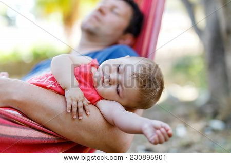 Cute Adorable Baby Girl Of 6 Months And Her Father Sleeping Peaceful In Hammock In Outdoor Garden. C