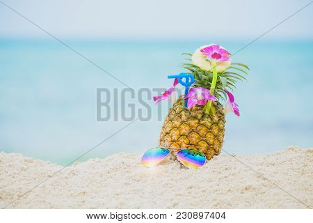 Purple Orchid Flower Put On Fresh Pineapple Juice And Sliced Pineapple Fruit With Sunglass On Beach