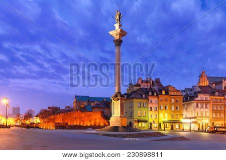 Castle Square With Royal Castle, Colorful Houses And Sigismund Column Called Kolumna Zygmunta In Old
