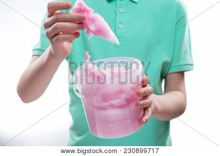 Sweet Pink Cotton Candy In The Hands Of A Teenage Boy