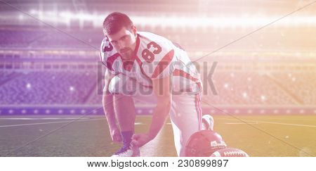 American Football Player preparing for match on big modern stadium field with lights and flares