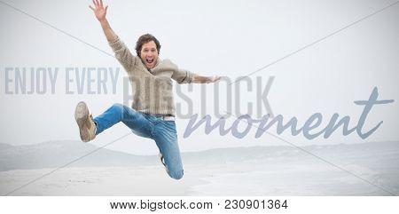 Enjoy every moment against portrait of young man jumping at beach