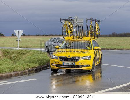 Cernay-la-ville, France - March 5, 2017: The Yellow Teachnical Mavic Car Taking A Bend On A Wet Road