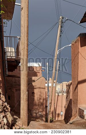 Houses Of Mud Brick, Plastered With Red Clay, On A Deserted Narrow Street In Abyaneh Village, Isfaha