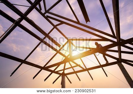 Silhouette Welder On Steel Roof Structure, Structure Of Steel Roof Frame For Building Construction O
