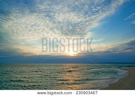 Coast Of The Sea At Sunset. On The Shore Of The Caspian Sea. The Caspian Sea Is The Largest Enclosed