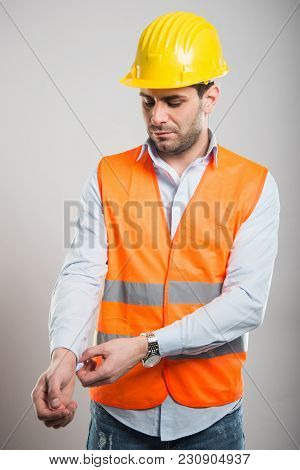 Portrait Of Young Architect Arranging His Shirt Sleeve