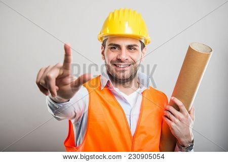 Portrait Of Young Architect Holding Blueprints Showing Two Fingers