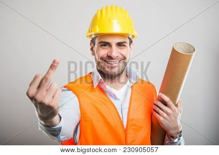 Portrait Of Young Architect Holding Blueprints Showing Middle Finger