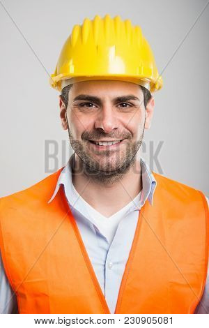 Portrait Of Young Architect Wearing Helmet And Smiling