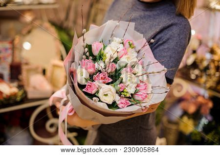 Woman Holding A Beautiful Bouquet Of Tender Flowers Consisting Of Pink Tulips And White Ranunculus