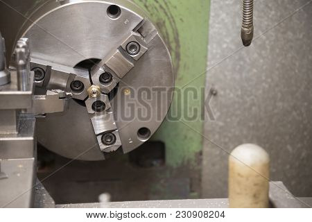 The Lathe Machine Or Turning Machine Cutting The Steel Nut Part With The Light Blue Scene.