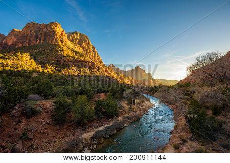 Sunset Over The Virgin River And The Watchman Peak In Zion National Park, Utah.