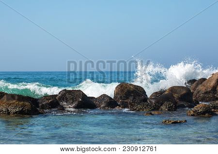 Waves Of The Indian Ocean Are Broken Against Stones