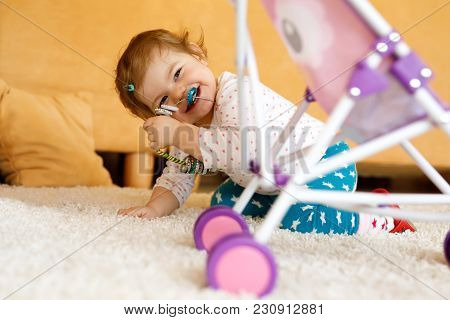 Happy Little Toddler Baby Girl Playing Hide And Seek At Home. Child Having Fun With Parents Or Sibli