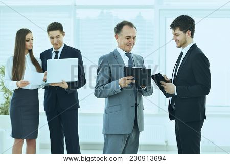 Successful Business Team Debating And Discussing Work In Front Of A Business Meeting In The Lobby