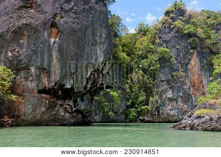 Tropical Forest Covered Limestone Cliffs At Phang Nga Bay