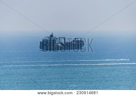 Photo Of Cargo Ship In The Roadstead