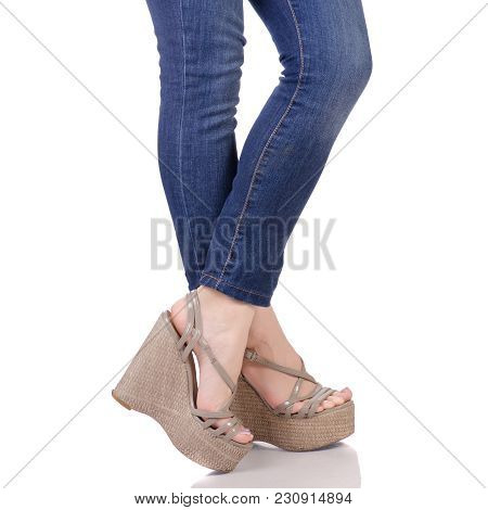 Female Legs In Jeans And Gray Sandals On A Wedge Buy Shop Fashion Beauty On A White Background Isola