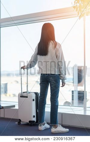 Airport Traveller Lifestyle Of Young Girl Passenger With Luggage In Airport Terminal Departure Hall