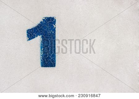 Number 1 (one) Is Written In Blue Paint On A Gray Metal Surface. Background, Texture