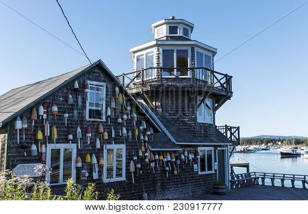Tremont, Maine, Usa - 30 July 2018: Lobster Buoys Are Hanging From A House Dedcated To Clarence Hard