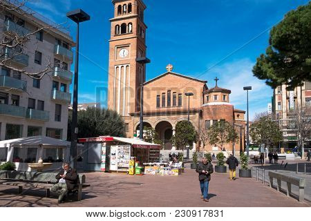 HOSPITALET DE LLOBREGAT, SPAIN - MARCH 9, 2018: A view of the facade of the Saint Eulalia of Merida church, placed in the Ajuntament square, the main square in the Hospitalet Centre district