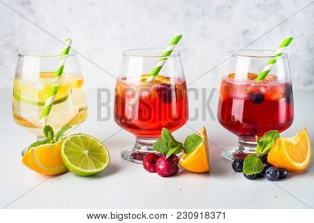 White, Pink And Red Sangria With Fruit And Ice. Traditional Summer Alcohol Drink.