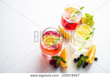 White, Pink And Red Sangria With Fruit And Ice. Summer Alcohol Drink.