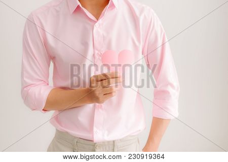 Handsome Asian Man Holding Pink Heart Paper Posing On Gray Background