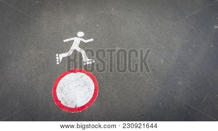 Sign Prohibiting Roller Skating Painted On The Asphalt. Forbidding Roller Skating.