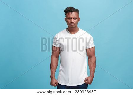 Angry, Hate, Rage. Emotional Angry Afro Man On Blue Studio Background. Emotional, Young Face. Front